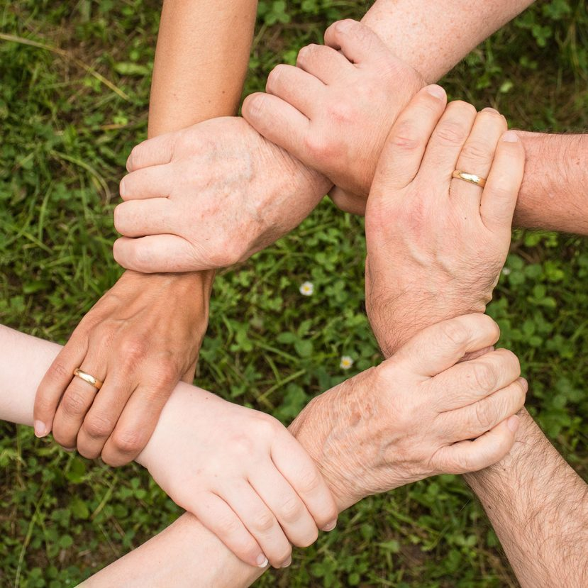 Image of interlocking hands