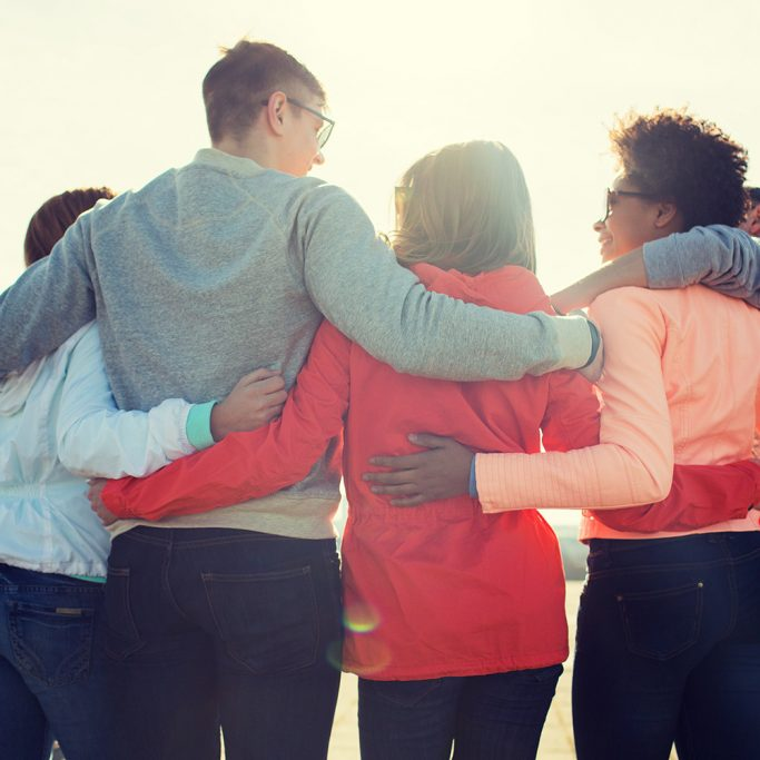 Image of friends hugging in a circle